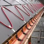 Какую систему антиобледенения крыши выбрать — водяную или электрическую?